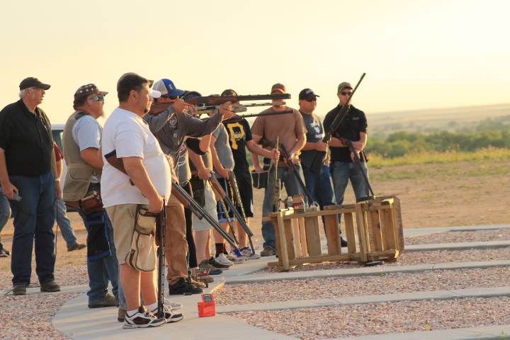 group of men shooting guns