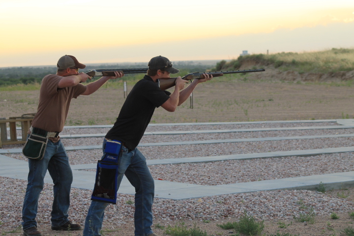 two men shooting guns